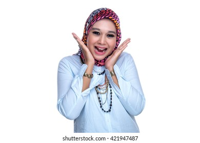 Portrait or close up of a young female Muslim lady with facial and hand expression on a white background