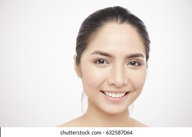 Portrait close-up of Asian girl smile on white background