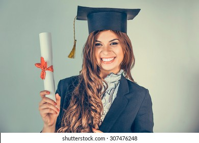 d9f6e24540b Portrait closeup beautiful smiley latina graduate graduated student girl young  woman in cap gown showing holding