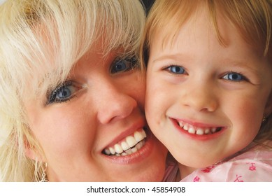 Portrait closeup fro three year old girl and blond mother. Happy family and childhood.