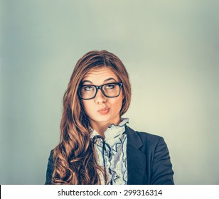 Portrait closeup funny confused skeptical woman girl female thinking with glasses looking up isolated green wall background copy space above head. Human expressions, emotions, feelings, body language