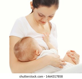 Portrait close-up happy mother feeding breast her baby isolated on white background