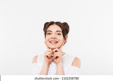 Portrait closeup of joyful smiling girl 20s with double buns hairstyle laughing and showing dental braces isolated over white background