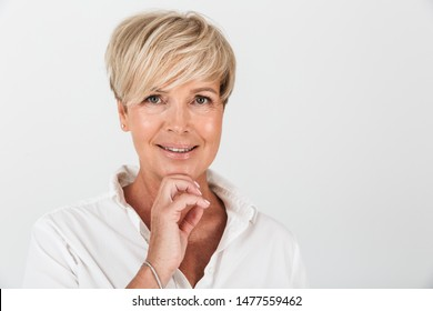 Portrait closeup of joyous adult woman with short blond hair smiling at camera isolated over white background in studio
