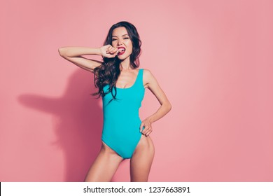 Portrait of cocky luxury chic thin fit slim lovely attractive adorable charming wavy-haired lady in tight blue outfit one-piece swimsuit biting nails isolated over pink background