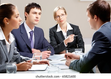 Portrait of colleagues planning their work in office