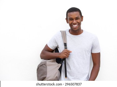 Portrait of a college student smiling with bag on white background
