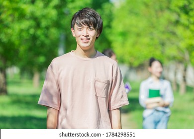 Portrait of a college student standing in the green