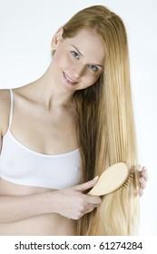 portrait of combing woman wearing underwear