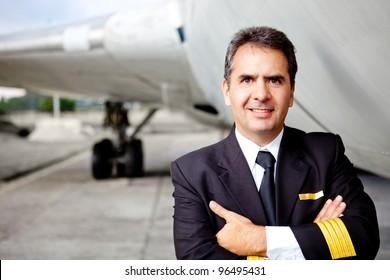 Portrait of a commercial airplane pilot smiling