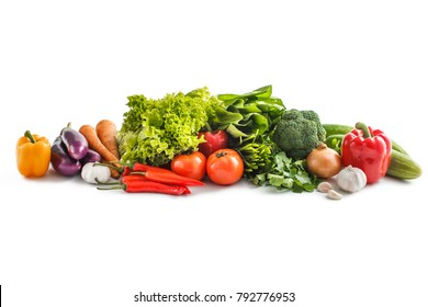 portrait of Composition with raw vegetables isolated on white