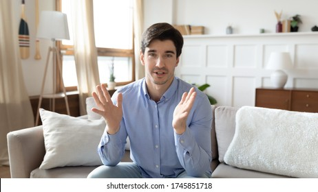 Portrait of concentrated male caucasian couch or tutor talk speak have video call, focused caucasian young man blogger or speaker shoot live broadcast vlog at home, have webcam conference