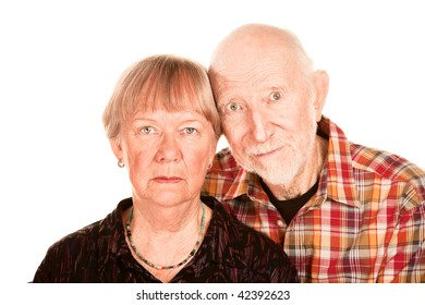 Portrait of concerned senior couple on white background