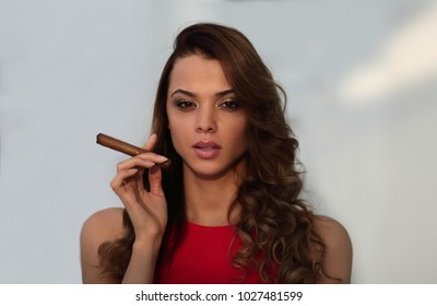 Portrait of confident adult woman with cigar