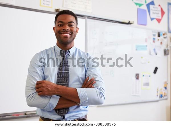 Portrait of confident African American male teacher in class