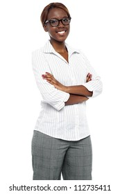 Portrait confident african woman executive posing with arms crossed isolated against white background