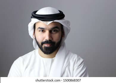 Portrait Of A Confident Arab Businessman Wearing UAE Emirati Traditional Dress