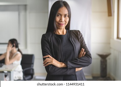 Portrait of Confident Asian business woman standing in the office.