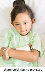 Portrait of Confident  Asian Ethnic Little Child Impatient in Hospital Smiling