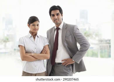 Portrait of confident business colleagues smiling together