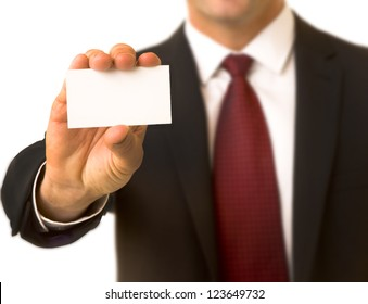 Portrait of a confident business executive holding up a business card, shallow focus with focus on card