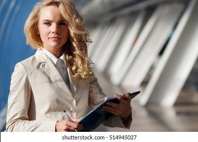Portrait of confident business lady inside modern office building