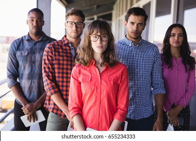 Portrait of confident business people standing in balcony