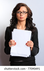 Portrait of confident business woman in the background documents
