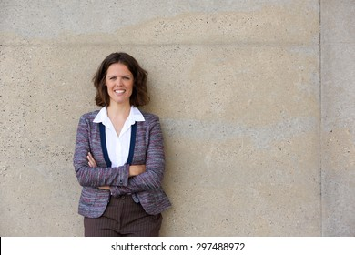 Portrait of a confident business woman smiling with arms crossed