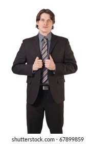 Portrait of a confident businessman adjusting his jacket over white background