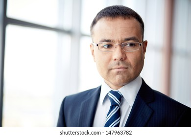 Portrait of confident businessman in eyeglasses