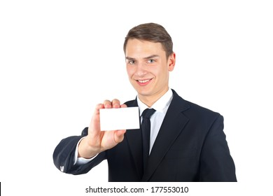 Portrait of a confident businessman holding a business card on isolated background