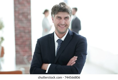 Portrait of confident businessman on office background