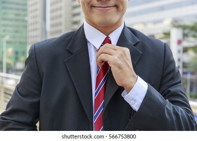 Portrait of confident businessman outdoors. Young Business man a new job, Shot of a senior lawyer standing in the city Background