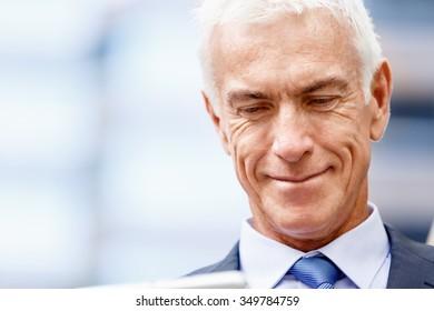 Portrait of confident businessman in suit outdoors