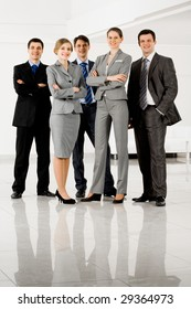 Portrait of confident businesspeople in smart suits standing on the floor