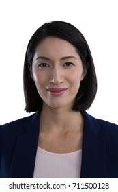Portrait of confident businesswoman against white background