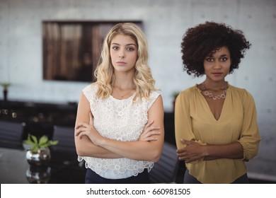 Portrait of confident businesswomen standing in office