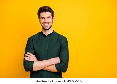 Portrait of confident cool entrepreneur guy cross hands look feel positive cheerful emotions real professional expert wear casual style clothing isolated over yellow color background