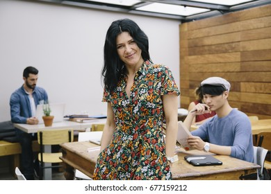 Portrait of confident creative businesswoman in coworking office