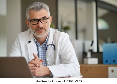 Portrait of confident doctor in private clinic