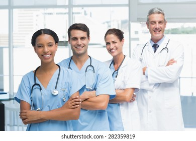 Portrait of confident doctors in row at medical office