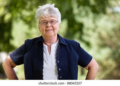 Portrait of confident elderly woman in park