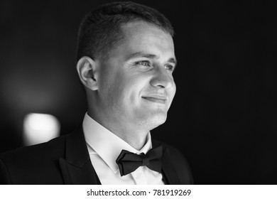 A portrait confident elegant handsome young man. Black and white photography.