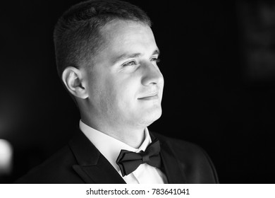 A portrait of a confident, elegant, handsome young man. Black and white photography.