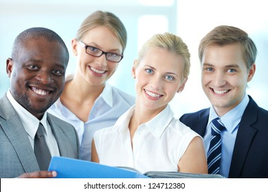 Portrait of confident employees looking at camera with smiles