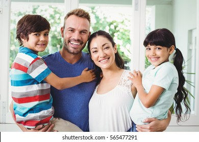 Portrait of confident family with children at home