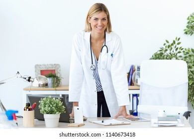 Portrait of confident female doctor looking at camera in the consultation.