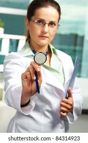 Portrait of confident female doctor with stethoscope looking at camera