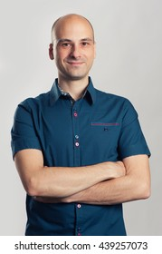 portrait of confident handsome bald man smiling